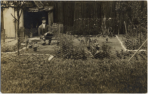GORGEOUS RPPC of EARL in his FLOWER GARDEN!