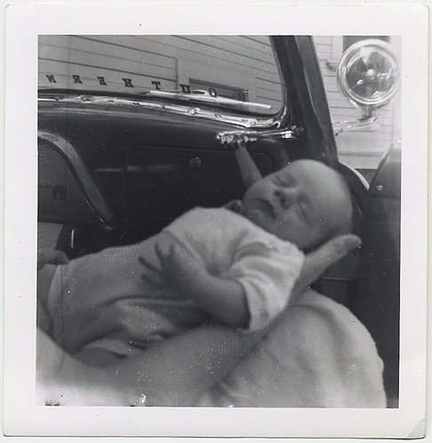 NEWBORN INFANT CRADLED in HAND in FRONT SEAT of VINTAGE CAR