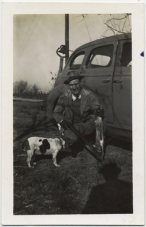 FREAKY HUNTER w DEAD RABBIT & HUNTING DOG AIMS GUN at SHADOW'S HEAD