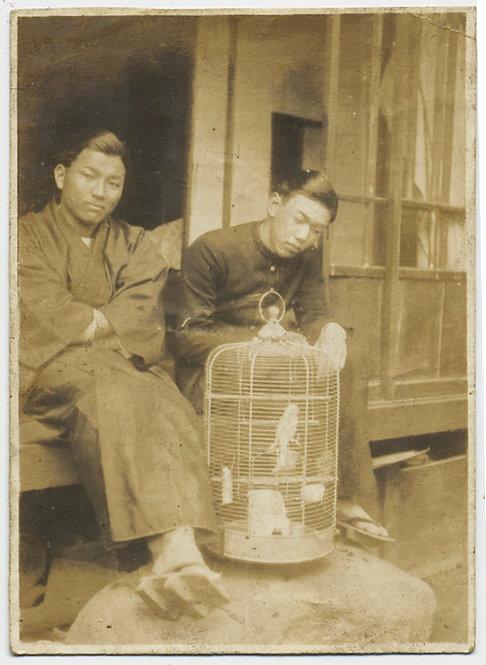 HANDSOME ASIAN MEN GUARD PET BIRD in CAGE HONG KONG? CHINA?