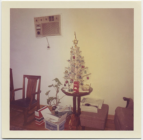 SAD SMALL SILVER XMAS TREE w OLD SPICE GIFT and AIR CONDITIONER