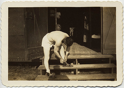 AFTER CALISTHENICS MISSISSIPPI TOPLESS SERVICEMAN ADJUSTS SHOE
