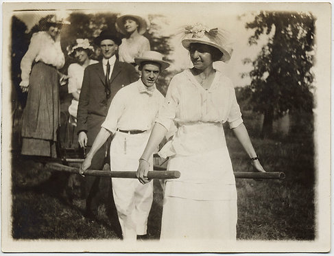 STRANGE COUPLE in WHITE HAUL CART with WOMEN in HATS and DAPPER MAN