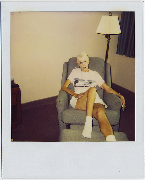 BLEACHED BLONDE WHITE WASHED OUT WOMAN smokes IN CHAIR! ALIEN!