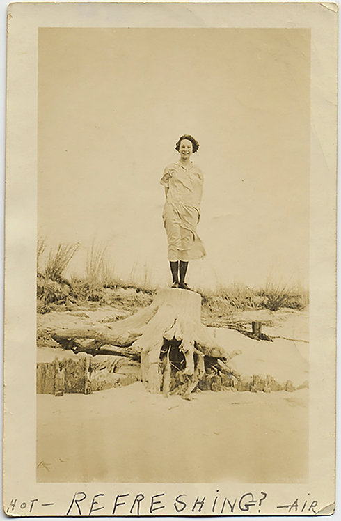 PRETTY WINDSWEPT WOMAN STANDS on BEACH TREE STUMP!  GREAT CAPTION: Refreshing!
