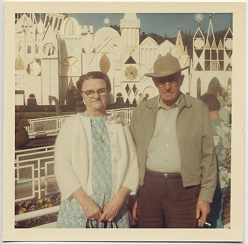 STRANGE AMERICAN GOTHIC COUPLE POSE at 70s SMALL WORLD RIDE DISNEYLAND ANAHEIM