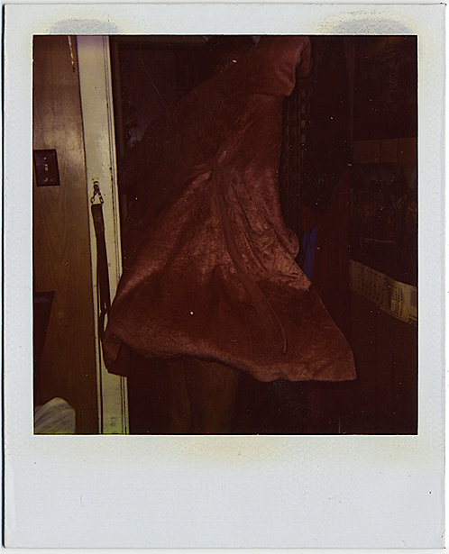POLAROID of WEIRD ODD BROWN AMORPHOUS DRESS and ABSTRACT FIGURE