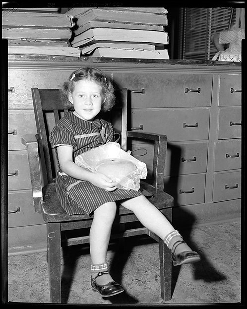 PRESS NEGATIVE ADORABLE LITTLE GIRL on CHAIR w BAKED GOODS in LAP