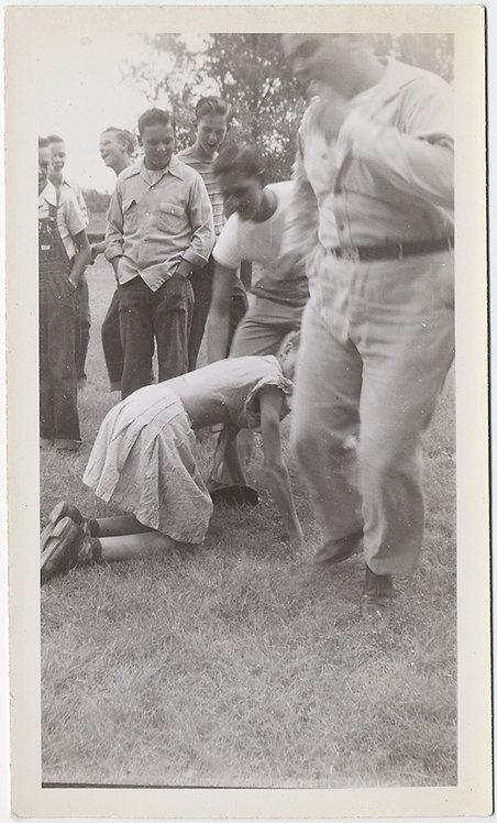 BIZARRE UNUSUAL WOMAN on HANDS & KNEES on GRASS GROUP of MEN WATCH!