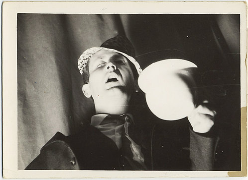STRANGE UNUSUAL MAN LIT from UNDERNEATH w GLOWING BALL MOUTH OPEN SURREAL