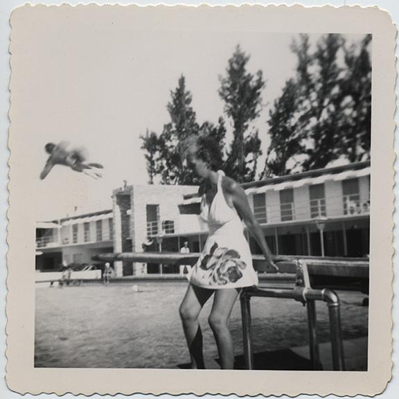 fp0109(WomanLeaningOnDivingBoard_ManDiving_swimmingPool)