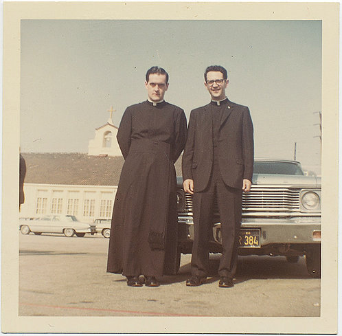 SERIOUS & SMILING PRIESTS POSE in front of VINTAGE CAR CHURCH PARKING LOT