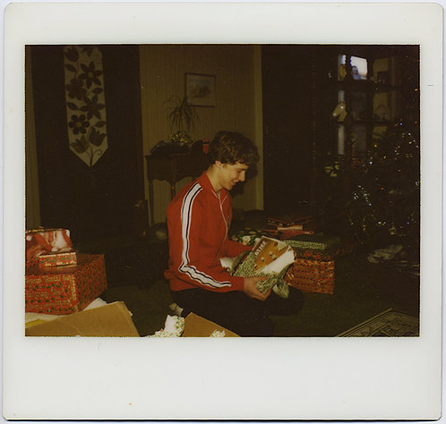 BOY in RED TRACKSUIT TOP opens GIFTS on XMAS POLAROID KODAK INSTANT