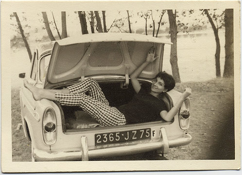 STYLISH FUN-LOVING EUROPEAN FRENCH? WOMAN in CHECK PANTS HANGS OUT in CAR TRUNK