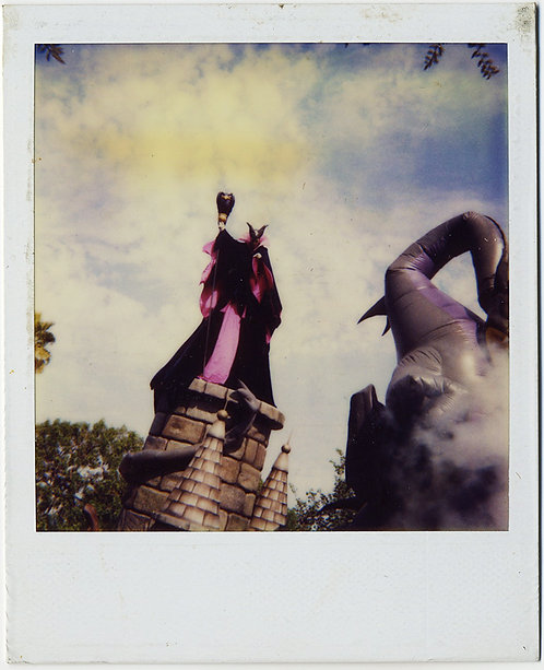 ALMOST ABSTRACT DISNEY EVIL QUEEN and INFLATEABLE ELEPHANT DO BATTLE