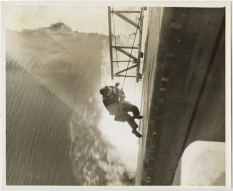 MAN SCALES HEIGHTS of BONNEVILLE DAM on FLIMSY ROP E& WOOD SEAT GUSHING WATER