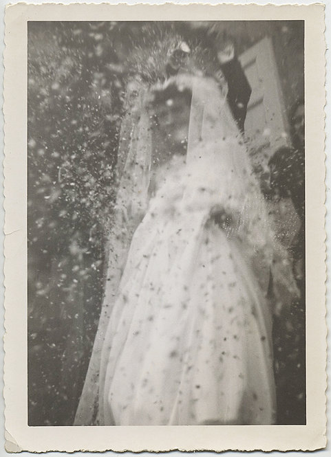 STUNNING ALMOST ABSTRACT BRIDE SHOWERED with CONFETTI RICE