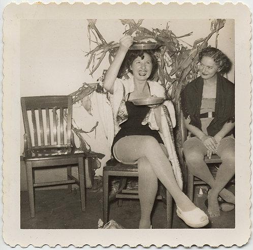WOMAN at HALLOWEEN PARTY BALANCES METAL PAN PLATE on HEAD STRANGE