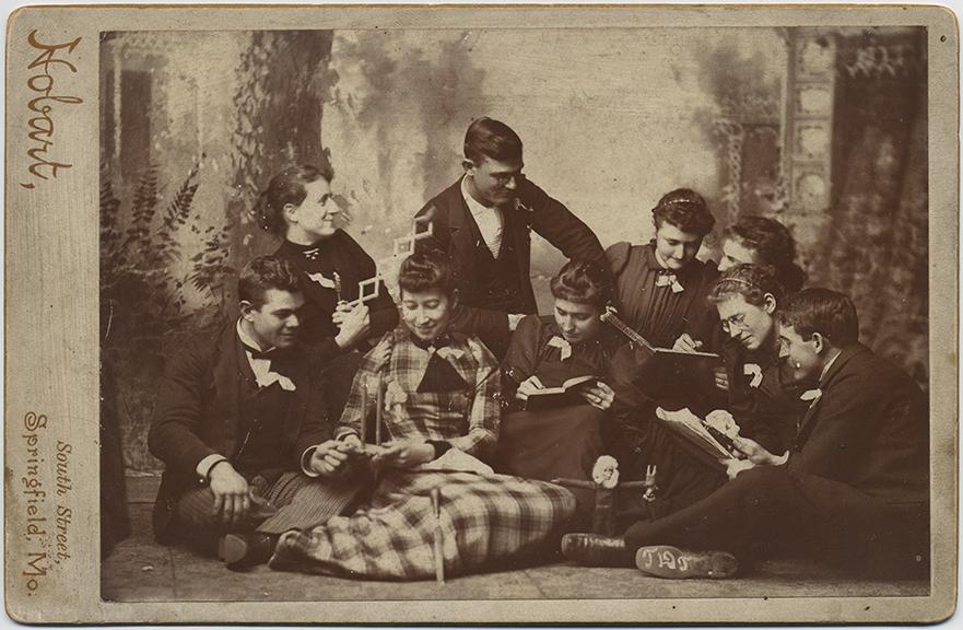 fp6485(Hobart_CC_Students_ReadingBooks_BeardedDoll)