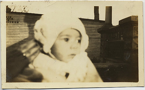HAUNTING image BABY and COMFORTING HAND w BUILDING & SIGNAGE BEHIND
