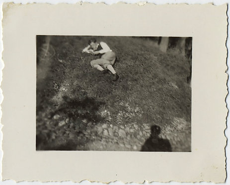 TINY PHOTO! SMALL IS BEAUTIFUL!  MAN READS READER on GRASS w SHADOW!