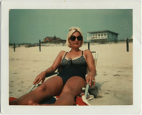 SHOCKING BLONDE MAMA LUXURIATES on BEACH w AWESOME HIP SUNGLASSES POLAROID