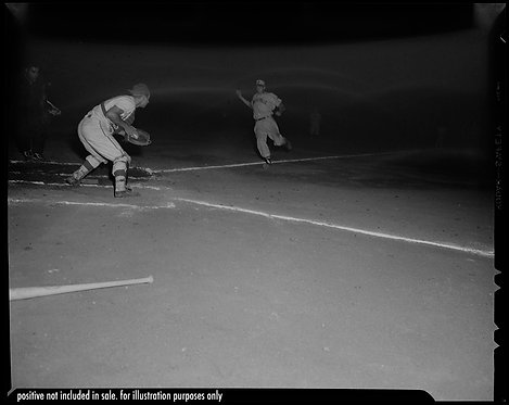 PRESS NEGATIVE The RUN TOWARDS HOME BASEBALL PLAYER RUNS to HOME BASE NIGHT GAME