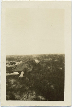 fp8741(Woman-Lying-Grass-Face-Covered)
