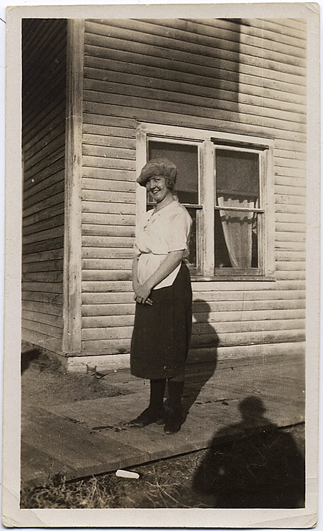 LOVELY CUTE SMILING WOMAN in HAT outside WOOD CLAD HOUSE SHADOW of PHOTOGRAPHER!