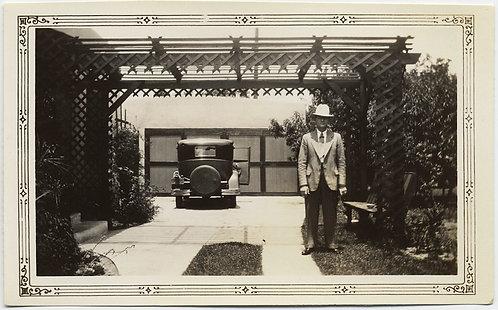 GREAT COMPOSITION STIFF MAN in HAT & VINTAGE CAR OPEN DOOR under NEAT PERGOLA