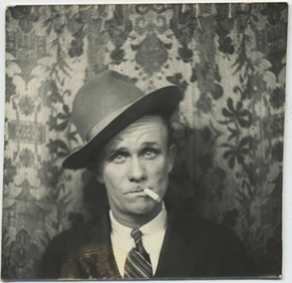 fp5258(Man_Headshot_CockedFedora_Cigarette)
