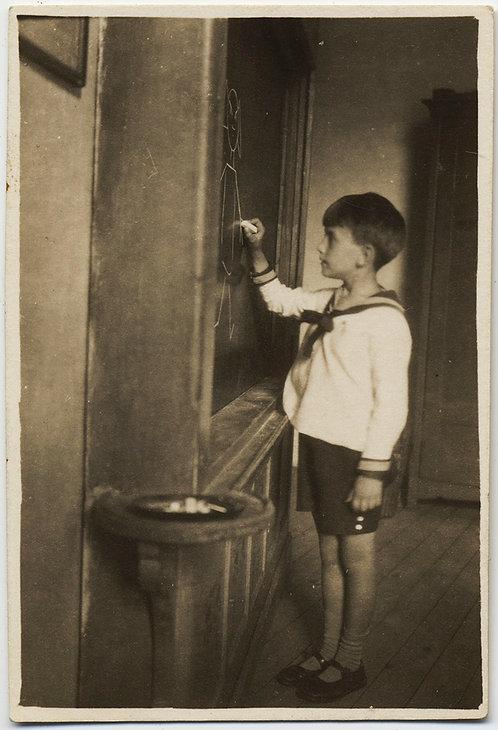 STUNNING LITTLE BOY in SAILOR SUIT DRAWS PORTRAIT FIGURE in CHALK on BLACKBOARD