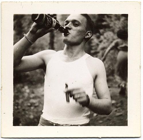 PLEASURE SEEKING HANDSOME MAN SMOKES CIGAR CHUGS BACK BEER in TANK TOP