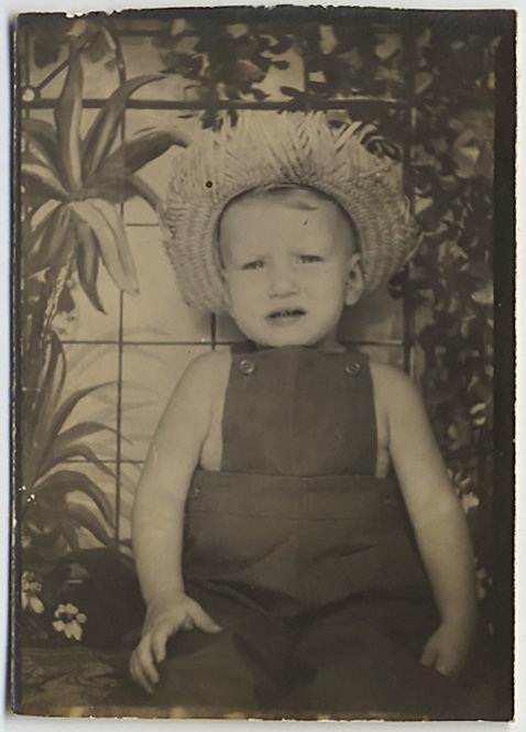 CUTE UNHAPPY TODDLER KID in STRAW HAT PHOTOBOOTH AGAINST LOVELY PAINTED BACKDROP