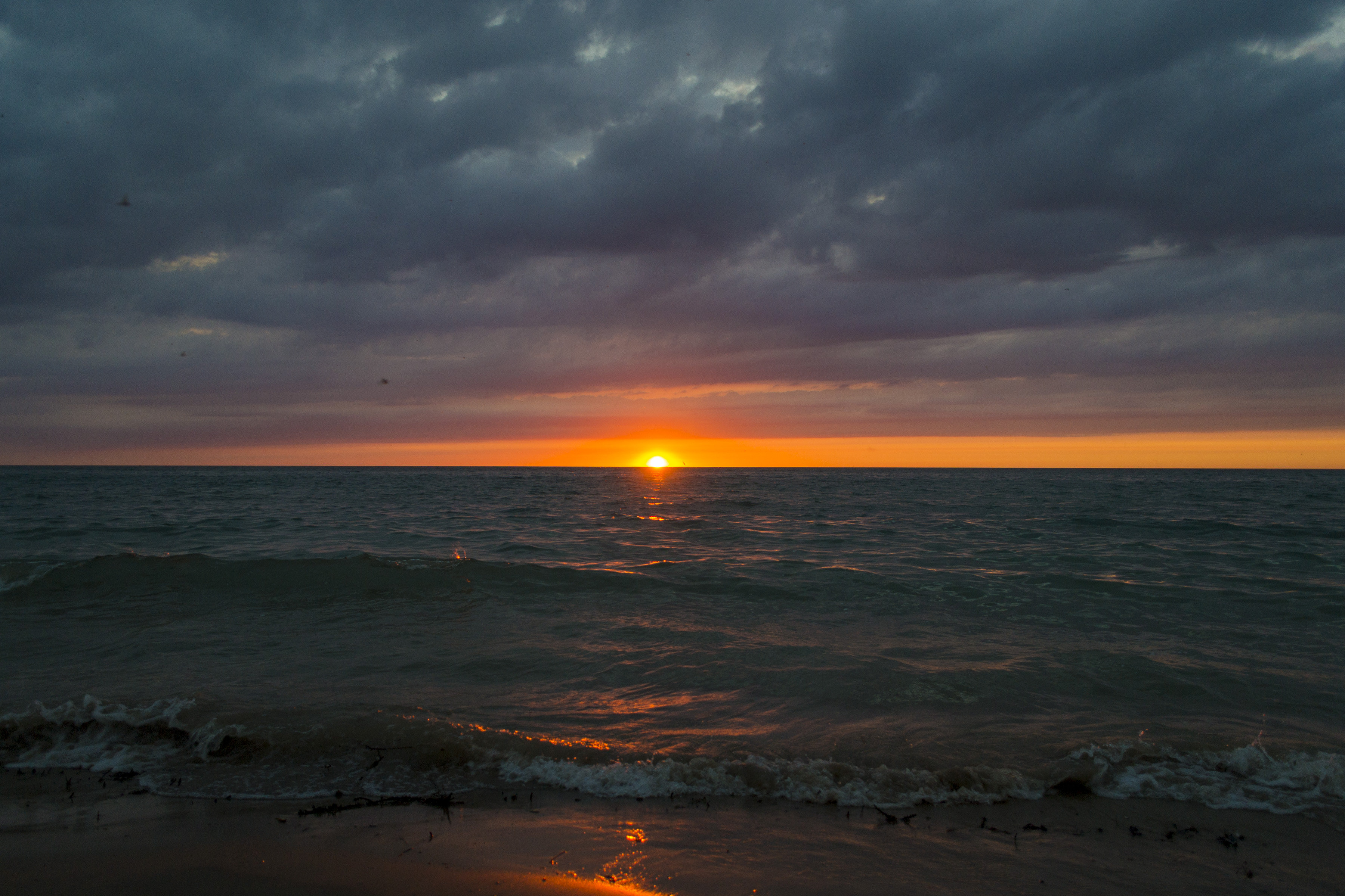 Stormy sun setting