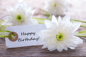 Label with Happy Birthday and White Blos
