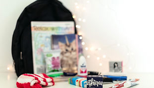 Backpack with products in front of it