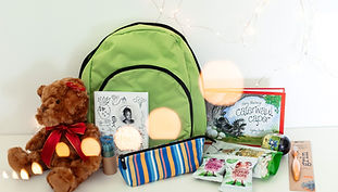 Kids pack items including green backpack, teddy, colouring book, Hairy Maclary book, snacks and supplies.