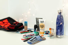 Collection of items for men's pack including razor, toothbrush, drink bottle and more.
