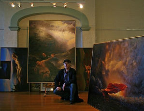 Kim Nelson with his artworks at Oddfellows Hall