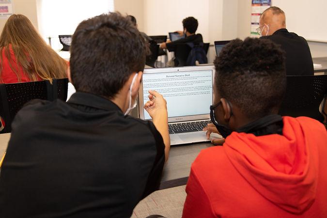 XL Academy Student Athletes looking at computer.jpg