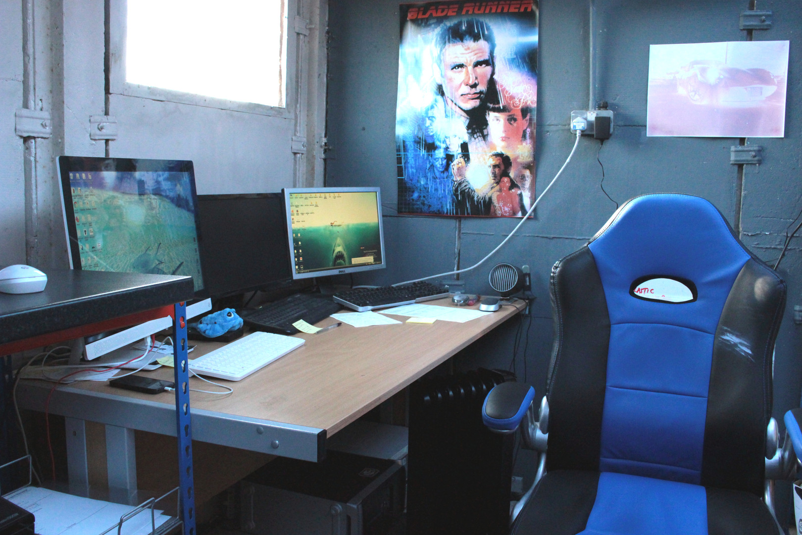 The workstation with cool BLADERUNNER poster