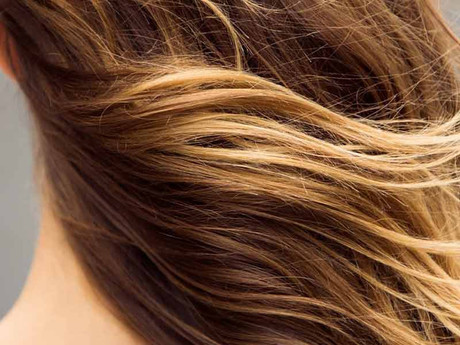 Why does my hair get brassy?