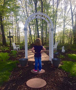 A child gazes at the Memorial Garden