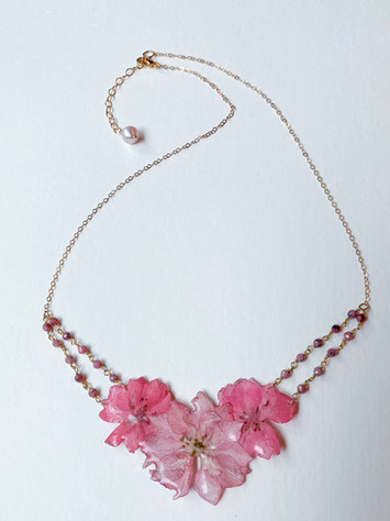 Pink larkspur in resin,faceted pink tourmaline and gold plated chain $110