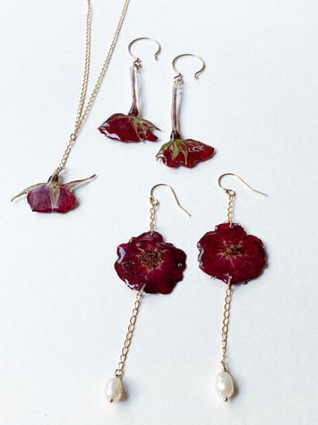 Dried red roses in resin. Rosebud necklace $60-SOLD ...Rosebud earrings $40 ...Rose blossom/pearl $50