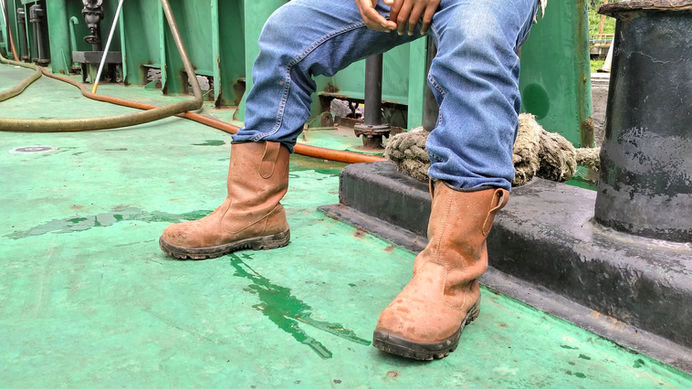 shoes and jeans of a worker who was sitt