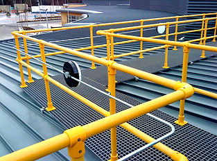 yellow grp handrails andgrp tue clamps on side of walkway