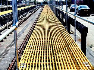 GRP walkway platform with steel handrail