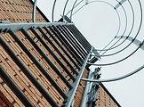 galvanised access ladder on brick building